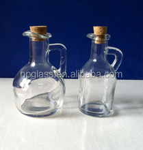 Beaked glass oil bottles with handle cork