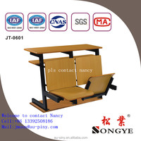 school wood chair with writing pad