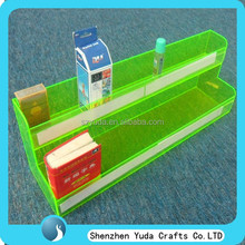 Two tiered fluorescent green acrylic cigarette display shelf for retail shops