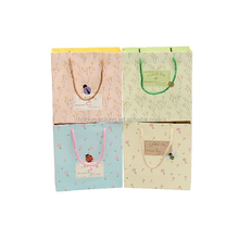 Custom handmade plain cute with your own logo printed paper handle cotton drawstring gift shopping carrier bag wholesale