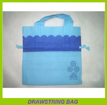 small blue non woven fabric drawstring birthday gift bag with handle