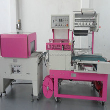 plc track vertical cutting personal stereo packaging machine with shrinking tunnel