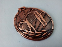 Classic blank sports medals with relief pattern of volleyball match in stock