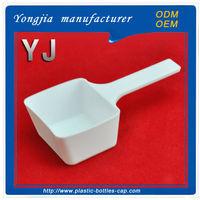 White square plastic washing powder spoon