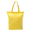 blank cotton tote bag in yellow color for shopping or travel carry