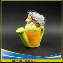 Ceramic garden ornaments hedgehog on watering pot