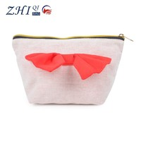 Elegant cheap wholesale canvas cosmetic bag with red bow and golden zipper for makeup girls
