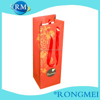 red color ribbon handle wine paper bag
