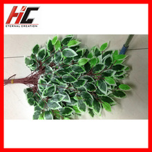 artificial palm tree leaves and plastic branches for outdoor decoration