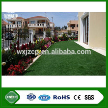 special yellow color synthetic turf grass for garden adornment with rock bottom price