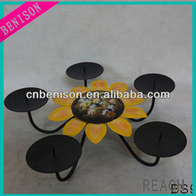 Black support classical candle holder with sunflower for decoration of table centre and hotel