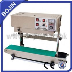 automatic continuous bag cap induction sealing machine