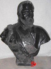 Ancient black marble man bust
