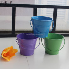 Small colorful metal buckets toys for kids garden or beach