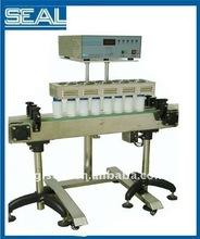 Auto induction cap sealer for medical bottling line