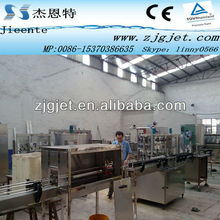 aluminum beverage can filling and sealing system