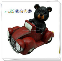 resin with driving black bear sculpture