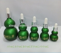 China wholesale gourd cucurbit shape green painted essential oil glass droppr bottle with logo printing