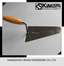 common polished bricklayer knife with painted wooden handle