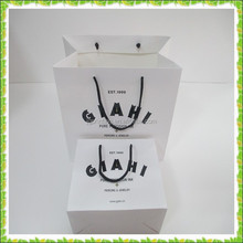 Full white carry paper bag with black rope handle Alibaba China