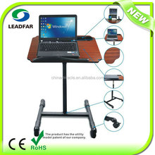 Removeable cooling adjustable laptop table with cup holder