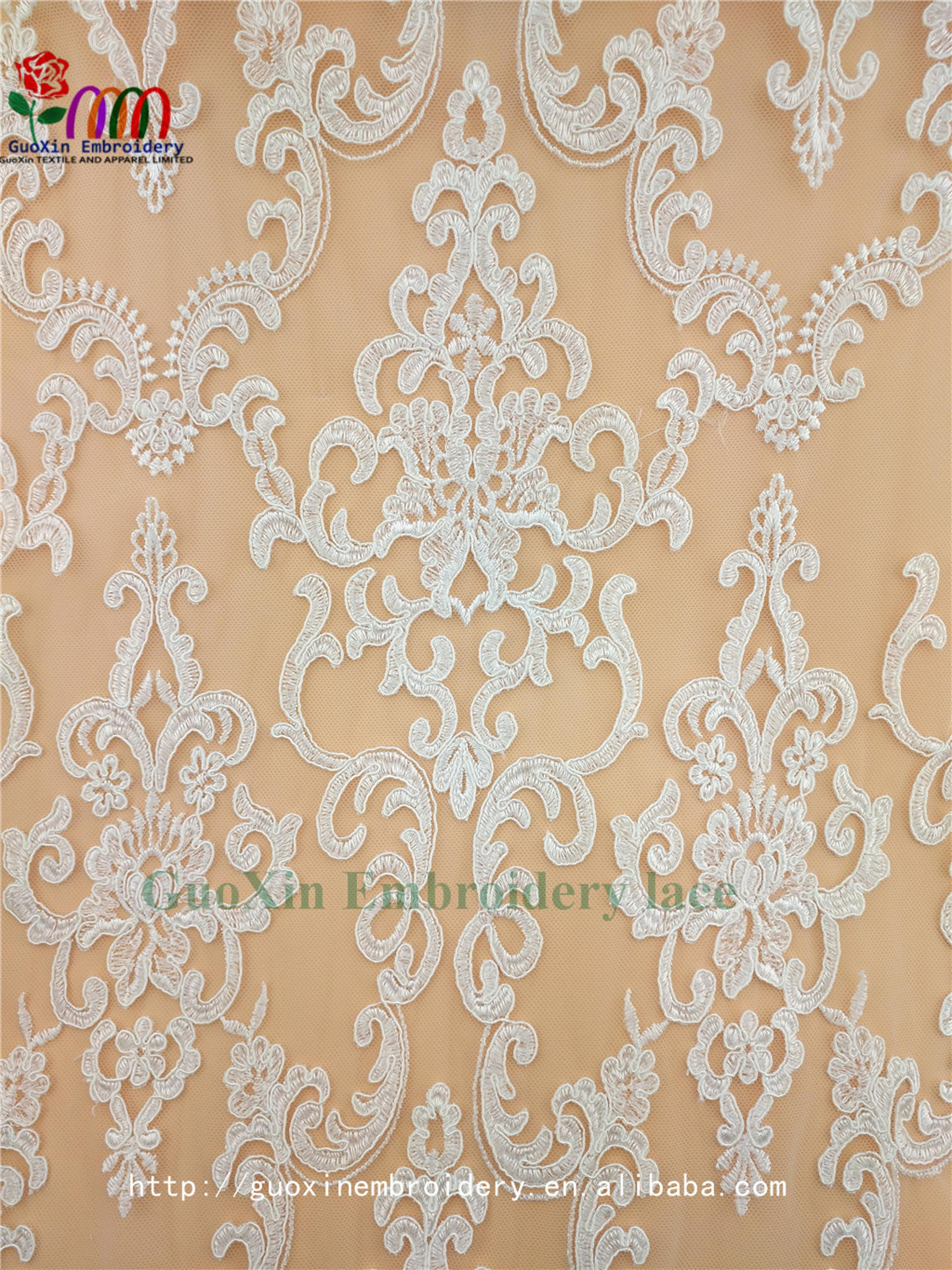embroidery tulle manufacture wholesale wedding veil ivory lace fabric with cording (1).jpg