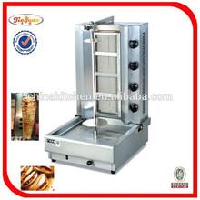 Pollo doner kebab máquina con 4 quemadores