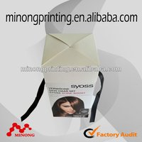printed paper production box with ribbon