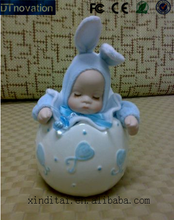 Baby rabbit ceramic shook head toy Music Box