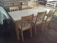 qingdao factory stock solid wood dining table sets include one table six chair,modern white design dining table sets