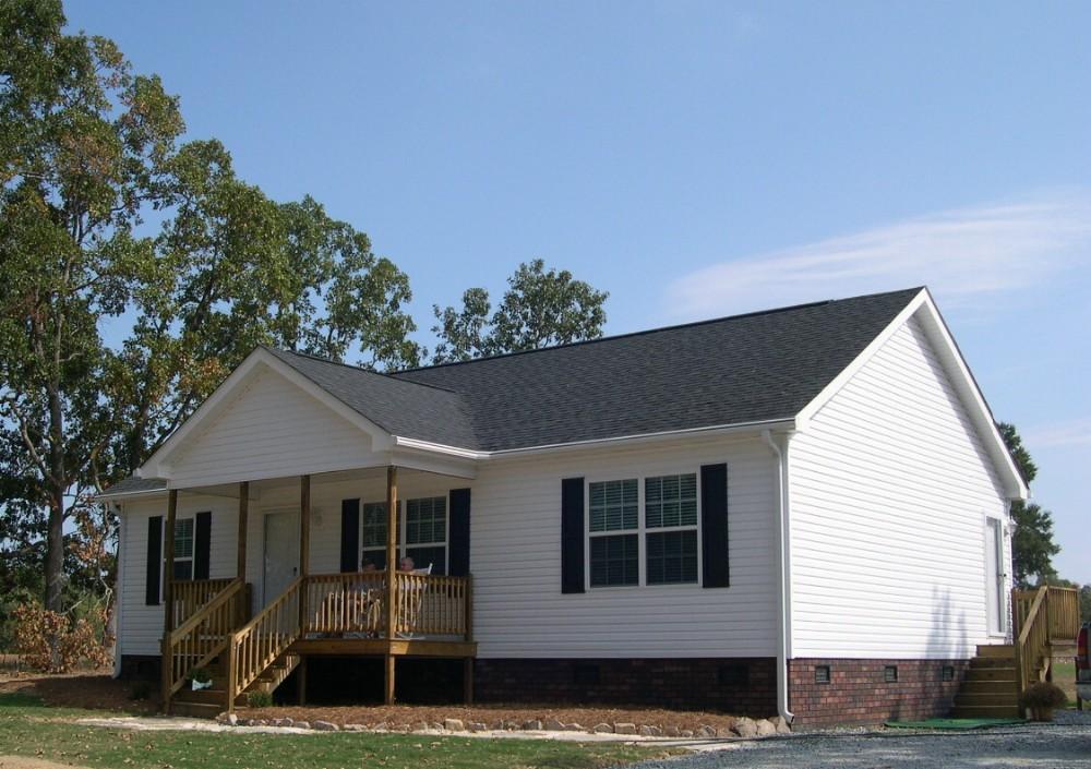 Maison en kit moderne maisons tmoins extension bois 51 for Maison hyper moderne