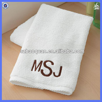 Cheap plain organic cotton towel with embroidered logo