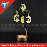 Direct factory cheap price rotating and spining metal tea light candle holder wholesale 2015