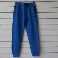 100% cotton men jogging pants with side waterproof pockets and logo print