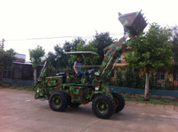 Small garden tractor with front end loader and backhoe