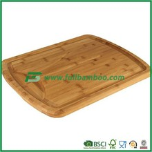 Square bamboo cutting board with a groove