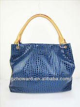 excess inventories blue color women handbags With a flash of female bag