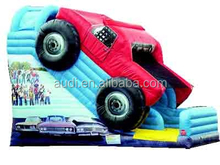 This awesome slide touts a big red inflatable monster truck driving over the top! Adorned with the latest in digital graphics an