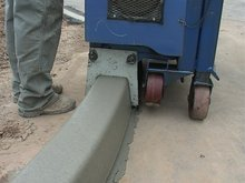 Mobile concrete & asphalt curbing machine