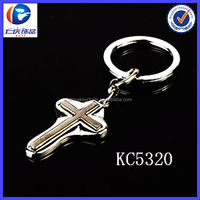 Wholesale new Sacred Surrounded by protective covers Cross shaped metal keychains