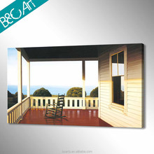 Reminiscent wood house and rocking chair late day seascape painting