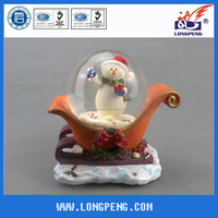 Musical Resin Christmas Snowman Snow Globe/Water Globe/Snow Ball with Sled for Christmas Decoration