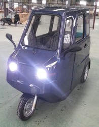 three wheel electric vehicle with window screen