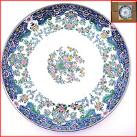 Round enamel plate with full flower painting.