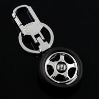 Promotional gift rubbuer metal 3D custom tire keychain with logo custom design