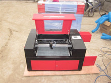 New laser engraving&cutting machine for leather/paper/wood/jewellery with parts optional and two years warranty!