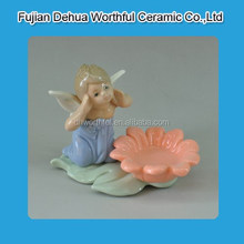 Popular angel with pink folwer white porcelain angle for home decoration