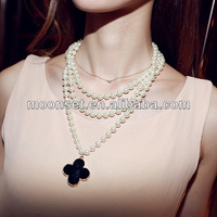 A clover grow a long chain pearl necklace pearl chain necklace designs bridal