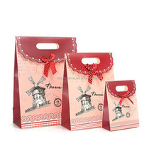 delicated high grade bowknot foldable custom logo printed creative luxury gift packing eco-friendy paper shopping bags