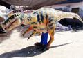 Parque de atracciones dinosaurio juego Velociraptor dinosaurio del traje